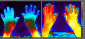 Two pairs of hands under thermal imaging camera